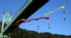Activists hang from the St. Johns bridge in an effort to block the  Royal Dutch Shell PLC icebreaker Fennica from leaving for Alaska in Portland, Ore., Thursday, July 30, 2015. The icebreaker, which is a vital part of Shell's exploration and spill-response plan off Alaska's northwest coast, stopped short of the hanging blockade, turned around and sailed back to a dock at the Port of Portland. (AP Photo/Don Ryan)